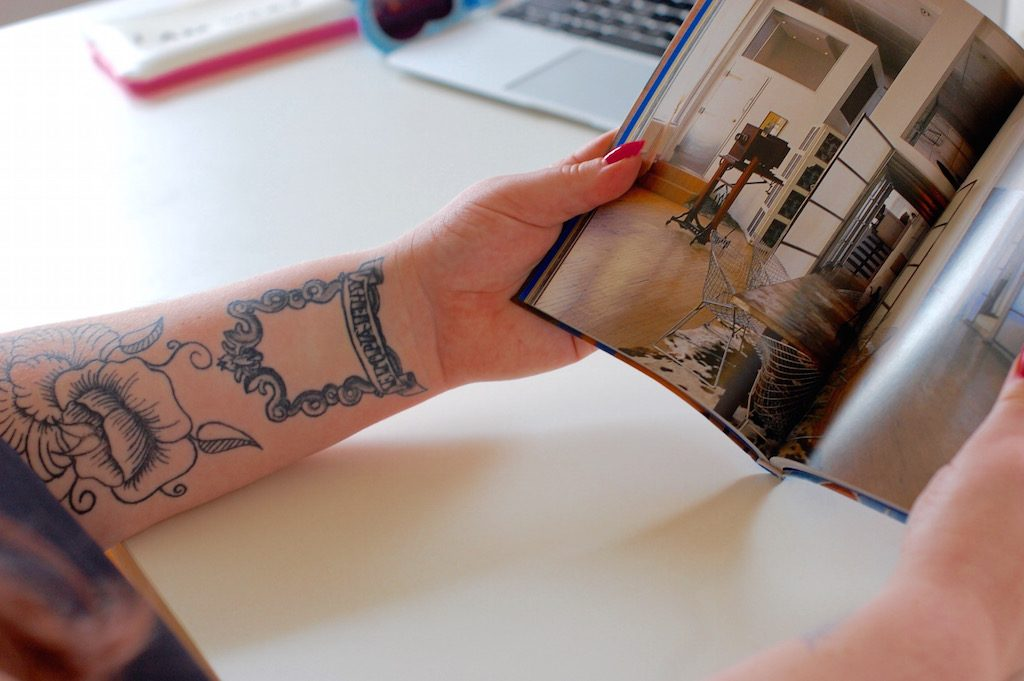 tattooarmslookingatdesignbook