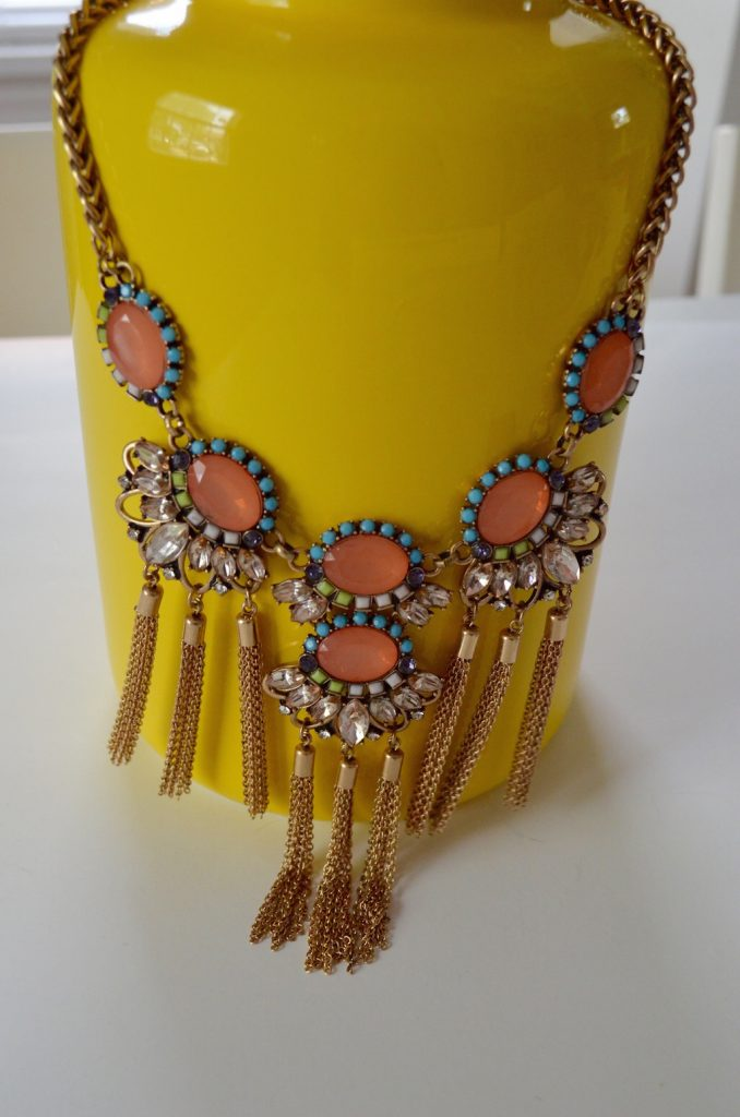 necklaceonyellowvasesticksandstones