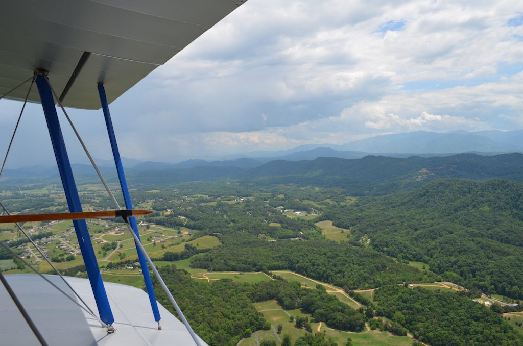 sideviewwithbiplaneandmountains